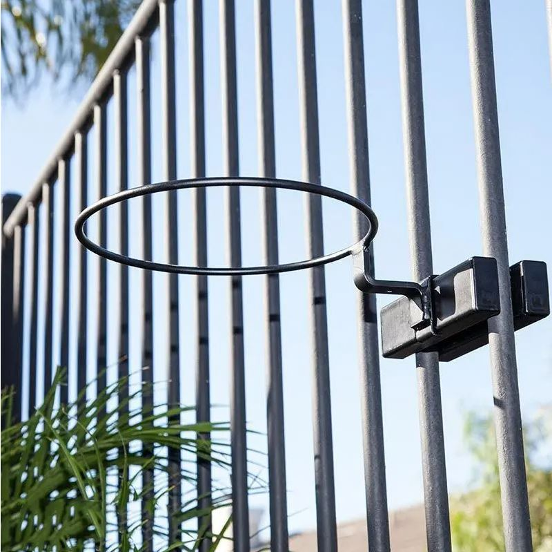 Round hoop that holds a flowerpot for a container garden attached to a railing