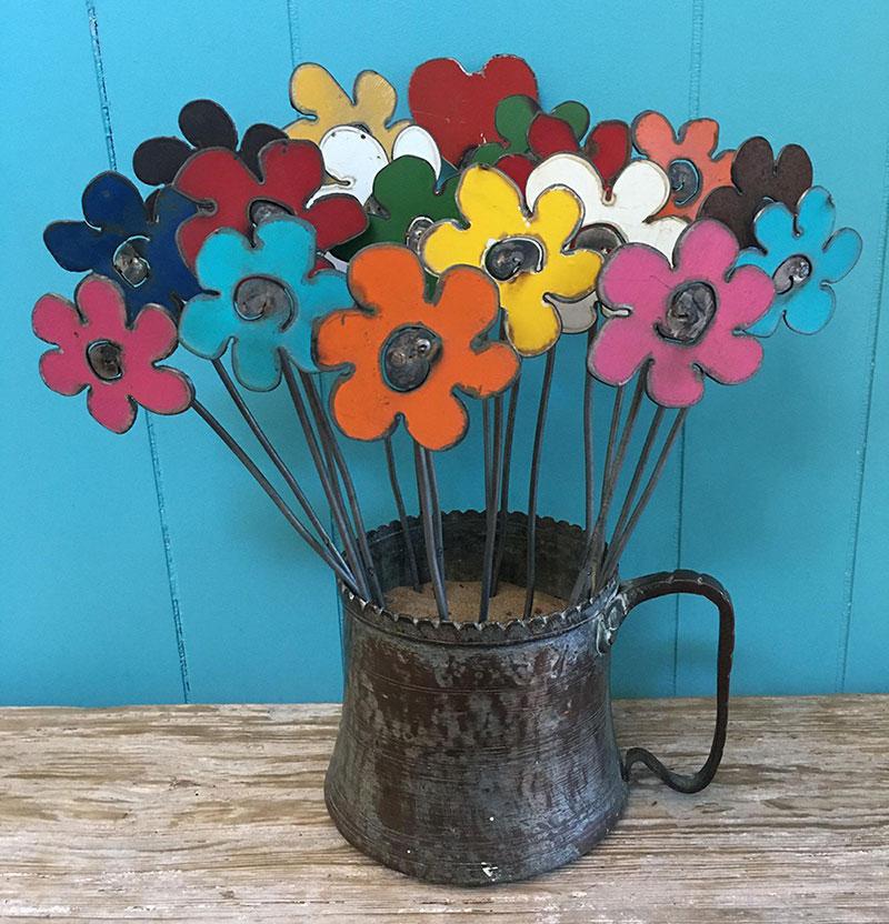 An unusual gift idea for beginner gardeners: decorative garden art like these rustic metal flowers