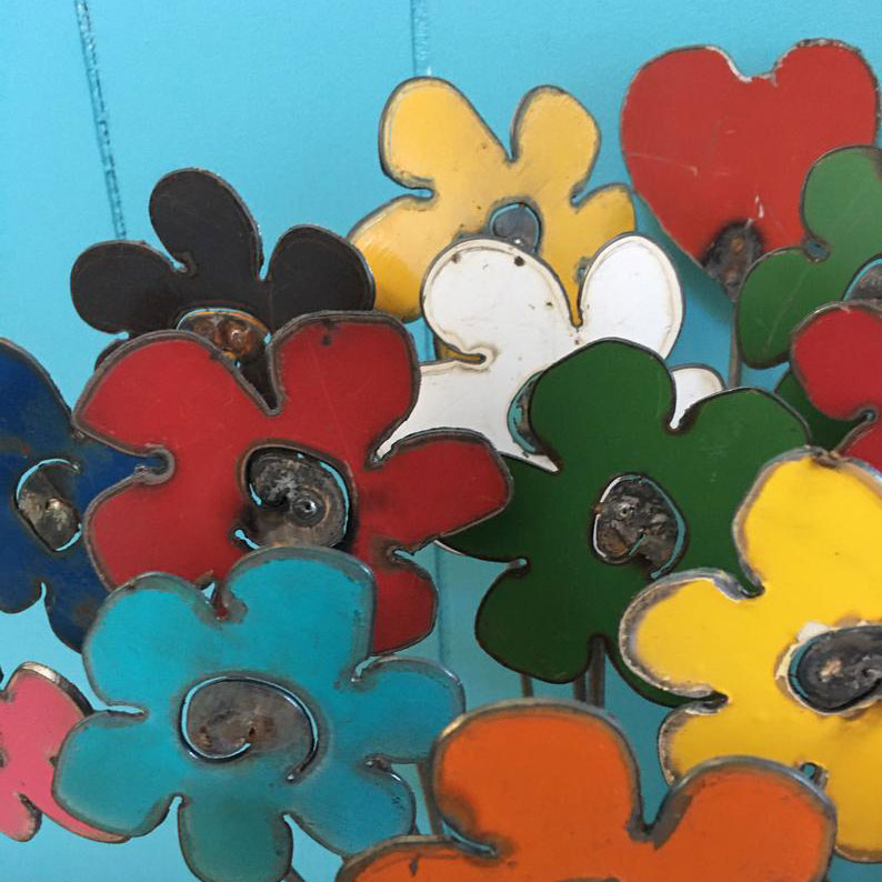 These colorful metal flowers are a unique gift idea for flower lovers, like your mom or wife