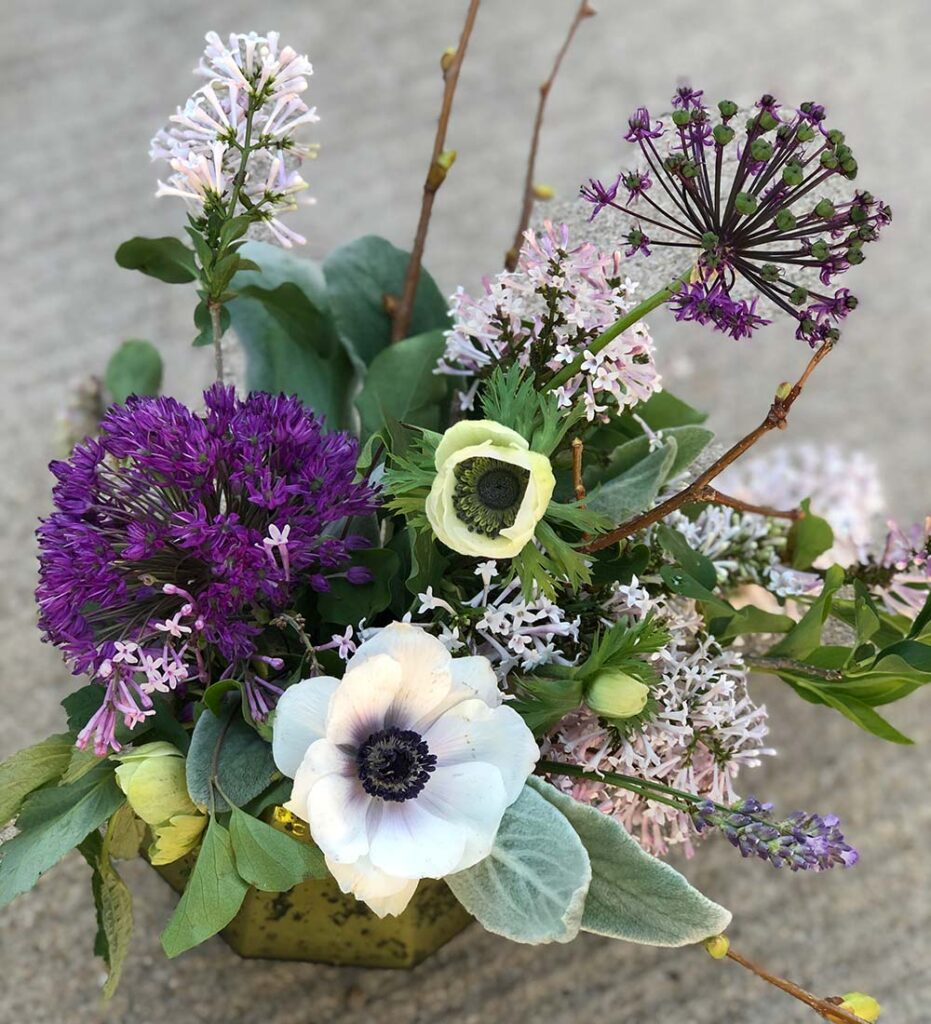 A creative flower bouquet with allium and anenomes