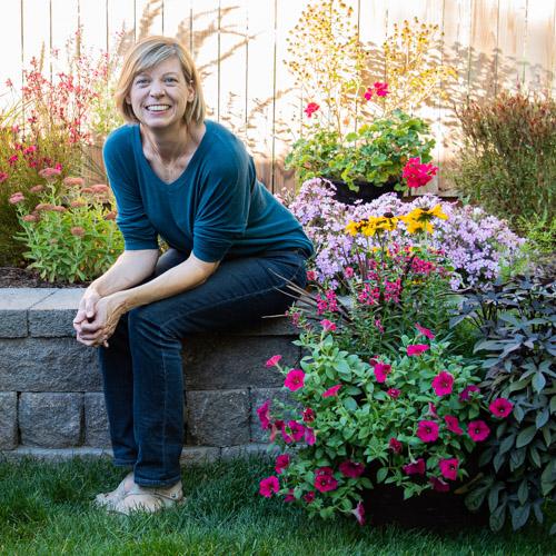 Ann from Go West Gardener with her flowerpots and garden
